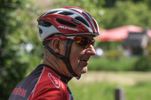 Elderly cyclist competing in race event